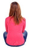 Opinião traseira a jovem mulher bonita que senta-se no floo Fotos de Stock