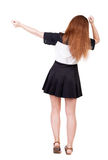 Opinião traseira a mulher alegre que comemora as mãos da vitória acima Fotografia de Stock Royalty Free
