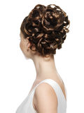 Opinião traseira a mulher com penteado curly Fotografia de Stock Royalty Free