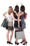 Opinião traseira a mulher três com saco de compras Imagem de Stock