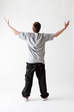Opinião traseira o adolescente no t-shirt cinzento Fotos de Stock Royalty Free