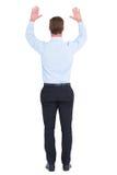 Opinião traseira o homem de negócios com mãos acima imagens de stock