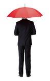 Opinião traseira o homem no terno com guarda-chuva Imagem de Stock