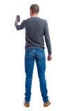 Opinião traseira o homem no terno que fala no telefone celular Foto de Stock Royalty Free