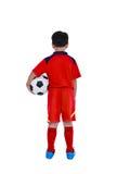 Opinião traseira o jogador de futebol asiático novo com bola de futebol estúdio Imagem de Stock Royalty Free
