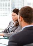 Opinião traseira um homem de negócios durante uma entrevista Imagens de Stock Royalty Free