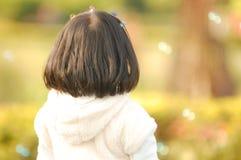 Opinião traseira uma menina asiática Fotografia de Stock Royalty Free