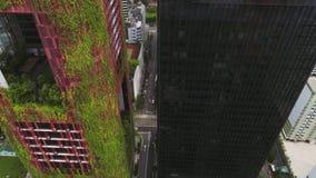 Opinión aérea del hotel de Singapur Oasia tiro Antena de rascacielos en Singapur céntrico metrajes