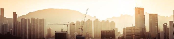 Opinión aérea del panorama de Hong Kong en la puesta del sol Imagen de archivo libre de regalías