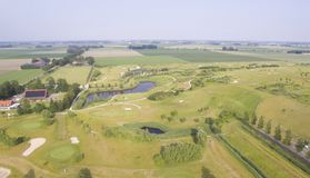 Opinión aérea sobre un campo de golf Imágenes de archivo libres de regalías