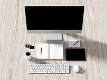 Opinión de alto ángulo de una tabla del ajuste de lugar de trabajo del negocio Foto de archivo