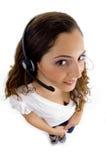 Opinión de alto ángulo la hembra del centro de atención telefónica foto de archivo libre de regalías