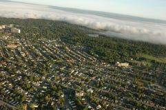 Opinión de Arial de la ciudad con las nubes Imágenes de archivo libres de regalías