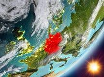 Opinión de la órbita de Alemania durante salida del sol stock de ilustración
