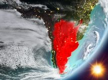 Opinión de la órbita de la Argentina durante salida del sol stock de ilustración