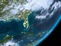 Opinión de la órbita de Bahamas en la noche stock de ilustración