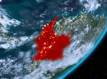 Opinión de la órbita de Colombia en la noche ilustración del vector