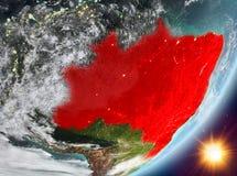 Opinión de la órbita del Brasil durante salida del sol ilustración del vector