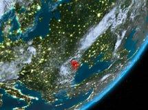 Opinión de la órbita del Moldavia en la noche stock de ilustración