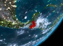 Opinión de la órbita de Guatemala en la noche stock de ilustración