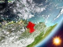 Opinión de la órbita de Guyana durante salida del sol ilustración del vector