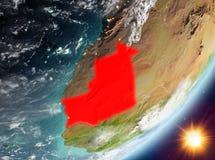 Opinión de la órbita de Mauritania durante salida del sol ilustración del vector