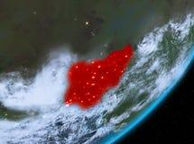 Opinión de la órbita de Nigeria en la noche ilustración del vector