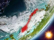 Opinión de la órbita de Noruega durante salida del sol stock de ilustración