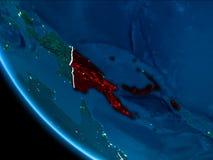 Opinión de la órbita de Papúa Nueva Guinea en la noche Fotos de archivo
