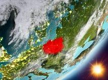 Opinión de la órbita de Polonia durante salida del sol ilustración del vector