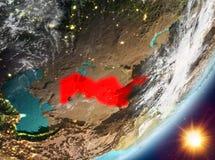 Opinión de la órbita de Uzbekistán durante salida del sol ilustración del vector