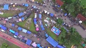 Opinión de la antena/del abejón del mercado semanal del ultramarinos en Indonesia almacen de metraje de vídeo