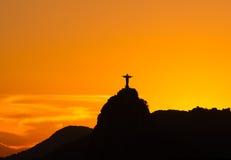 Opinión de la puesta del sol Cristo el redentor en Rio de Janeiro Fotos de archivo