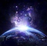 Opinión de la tierra del espacio en la noche imagenes de archivo