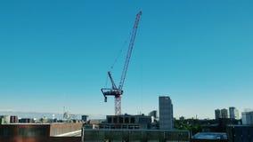 Opinión de lapso de tiempo de la construcción Crane Working en Boston almacen de metraje de vídeo