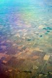Opinión de ojo de pájaros del cultivo de centro de la irrigación del pivote Imágenes de archivo libres de regalías