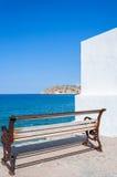 Opinión de Spinalonga de un banco en Plaka, Creta fotos de archivo libres de regalías
