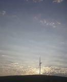 Opinión del molino de viento y de la puesta del sol Foto de archivo