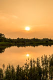 Opinión del paisaje con tiempos de la puesta del sol Foto de archivo libre de regalías