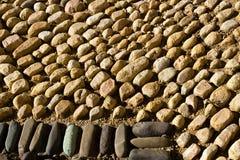 Opinión del primer de los adoquines ligeros y oscuros del pavimento, México Foto de archivo