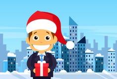 Opinión del rascacielos de la ciudad de Gift Box Winter del hombre de negocios stock de ilustración