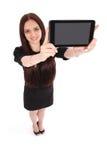 Opinión feliz del adolescente del estudiante desde arriba y mostrando una tableta Imagenes de archivo