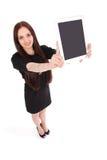 Opinión feliz del adolescente del estudiante desde arriba y mostrando una tableta Imagen de archivo libre de regalías