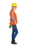 Opinión femenina de Full Length Side del trabajador de construcción Foto de archivo libre de regalías