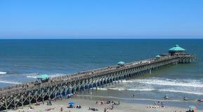 Opinión larga del embarcadero en la playa de la locura en el SC Imagen de archivo libre de regalías