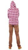 Opinión posterior el adolescente en una camisa de tela escocesa con la mirada del capo motor Imagen de archivo libre de regalías