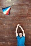 Opinión superior el hombre en piso de madera Fotografía de archivo libre de regalías