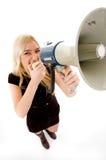 Opinión superior la hembra que grita en altavoz Fotos de archivo
