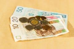 Opinión superior polaca de los billetes de banco y de las monedas del dinero Foto de archivo libre de regalías