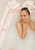 Opinión superior una muchacha en baño de la leche Imagen de archivo